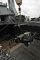 US Navy 111009-N-MW330-130 Sailors aboard the forward-deployed amphibious dock landing ship USS Germantown (LSD 42) raise a vehicle from the well d.jpg