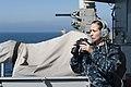 US Navy 111011-N-RR095-145 Seaman Samantha George stands aft lookout watch aboard the amphibious assault ship USS Makin Island (LHD 8).jpg