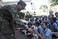 US Navy 111125-A-IP644-019 A Sailor distributes.jpg