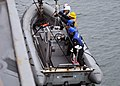 US Navy 111130-N-ZF681-232 Sailors aboard the guided-missile destroyer USS Halsey (DDG 97) are lowered into the ocean in a rigid hull inflatable.jpg
