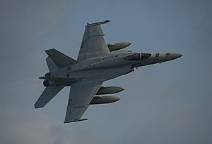 US Navy 120102-N-DR144-571 A jet conducts a fly over while underway.jpg