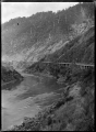 View of the railway line with retaining walls, running along the side of the Manawatu River in the Manawatu Gorge, at the Woodville end ATLIB 311384.png