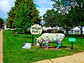 Village Park Sign and Cow Statue - panoramio.jpg