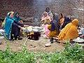 Village women making bread on fire in Pakistan.jpg