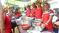 Villagers at Saligao, Goa, serve food to all present during the Sao Joao (Vangodd de Saligao) festival in Goa.jpg