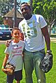 Vladimir Guerrero playing catch with a young fan 2014.jpg