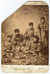 Vladimir Serafimov (sitting with a scarf over the head) with other soldiers from the Serbo-Bulgarian War.jpg