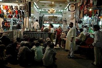 Zakat - Recipients waiting to receive zakat in India.