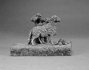 Sheep leaning against a bush