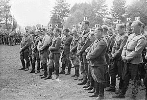 Adolf Pilch - Field mass for Polish partisans in the Kampinos forest, late 1944.  Pilch is third from the left (click on image for zoom and full description).