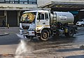 Water truck spraying down streets near Cape Town train station.jpg