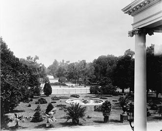 North Lawn (White House) - The North Lawn and a column of the North Portico photographed from the present President's Dining Room c. 1902.