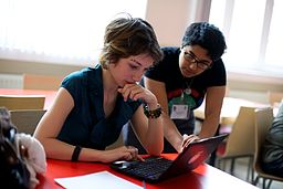 Sumana teaching a workshop participant at the Wikimedia hackathon in Amsterdam, 2013, by Sebastiaan ter Burg from Utrecht, The Netherlands (Wikimedia Hackathon 2013) [CC-BY-2.0 (http://creativecommons.org/licenses/by/2.0)], via Wikimedia Commons