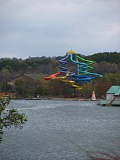 Multicolored water slide in wooded setting