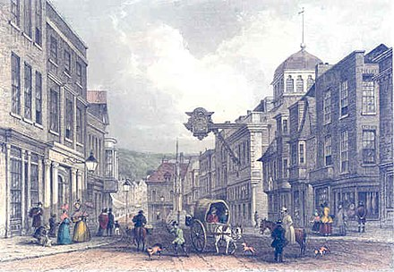 Winchester High Street in the mid 19th century. Winchester High Street Mudie 1853.jpg