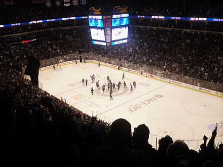 The Winnipeg Jets celebrate their first regulation win in Winnipeg at the MTS Centre on 17 October 2011 Winnipeg Jets first home victory celebration.jpg
