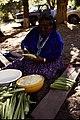 Woman making tamales. Slide says 'CADA'. (e7edef3809c34632acd180954ff4736b).jpg