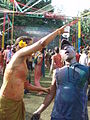 Woman pouring bhang on a man during a Holi party in India (415457164).jpg