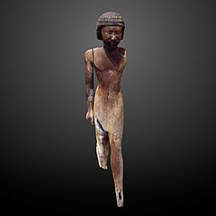 Wooden statue of a man-E 32 885