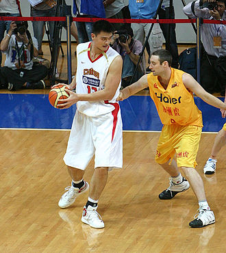 NBA Store - International players like Chinese Yao Ming (in white) have increased interest abroad and opened opportunities in China.