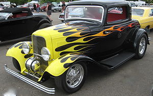 Custom car - '32 3-window with a classic-style flame job and Moon tank, reminiscent of Chapouris' ''California Kid''.