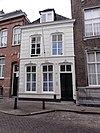 foto van Huis met gebosseerd gepleisterde gevel