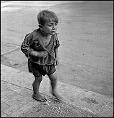 """Children In Naples, Italy"". Little boy crying. Photographed by Lieutenant Wayne Miller, August 1944. U.S. Navy Photograph, now in the collections of the National Archives.jpg"