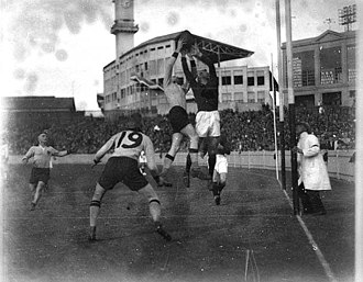 A New South Wales player marks over a West Australian opponent in the goal square at the 1933 Australian Football Carnival. The old Sydney Showground is in the background 05129r.jpg