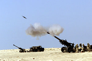 11th Marine Regiment (United States) - A 155mm artillery shell hurtles out of the barrel of an 11th Marine Regiment M-198 howitzer