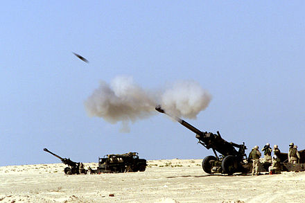 A 155 mm M198 howitzer firing a shell 155fire.jpg