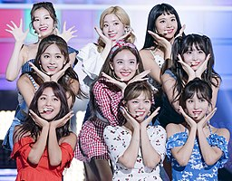 Twice performing Cheer Up in July 2018 Left to right, back to front: Sana, Dahyun, Chaeyoung, Tzuyu, Nayeon, Momo, Jihyo, Jeongyeon, and Mina