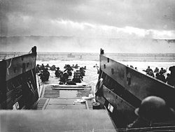 A Navy LCVP disembarks troops at Omaha Beach.