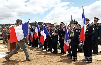Battle of Chipyong-ni - French veterans of the battle in Chipyong-ni received flags from Korean soldiers on a victory ceremony in 2012.