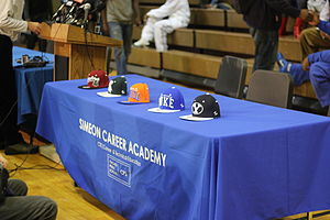 National Letter of Intent - Image: 20121220 Jabari Parker verbal commitment press conference team hats