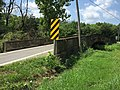 2016-07-29 12 30 23 A one-lane bridge used by Maryland State Route 56 (Big Pool Road) to cross Conococheague Creek in Charlton, Washington County, Maryland.jpg