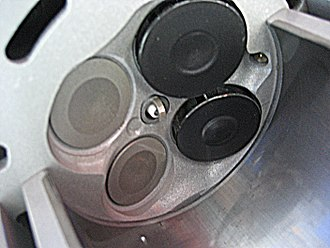 Multi-valve - Combustion chamber of a 2009 Ford Ecoboost 3.5-liter turbocharged V6 petrol engine (77.8 kW/liter) showing two intake valves (right), two exhaust valves (left), centrally placed spark plug, and direct fuel injector (right).