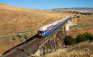 Altamont Corridor Express - ACE train traversing Altamont Pass Road while climbing Altamont Pass
