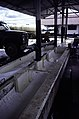 ASC Leiden - F. van der Kraaij Collection - 13 - 021 - The Firestone rubber plantation. Interior of the latex factory. Gutter for newly arrived latex - Harbel, Montserrado county, Liberia - 1976.jpg