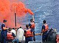 A Coast Guard crewmember provides pyrotechnic training to a U.S. Naval Sea Cadet Corps cadet aboard the Coast Guard Cutter Galveston Island (WPB 1349) off Honolulu.jpg