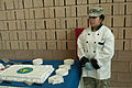 A Soldier with the 364th Expeditionary Sustainment Command stands ready to serve cake to guests attending the opening of the Marysville Armed Forces Reserve Center in Marysville, Wash., April 1, 2012 120401-A-RB545-953.jpg
