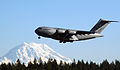 A US Air Force (USAF) C-17A Globemaster III takes off with Mount St 050208-F-ZS322-004.jpg