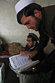 A local Afghan delivers a message to the sub-governor inside an Afghan Uniformed Police compound, in the Dur Baba district, Nangarhar province, Afghanistan, Feb 120213-A-LP603-053.jpg
