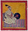 A nobleman seated on a striped rug (6125122984).jpg