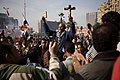 A protester in Tahrir Square holds up a copy of the Koran and a Christian cross - 30-Nov-2012.jpg