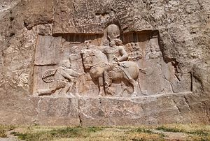 A rock-face relief of Shapur I over the Roman Emperor Valerian.jpg
