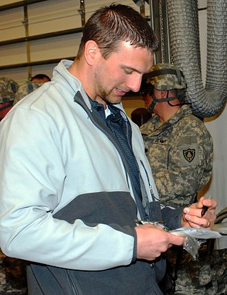 Aaron Kampman - Kampman signing autographs for U.S. troops in Fort Riley