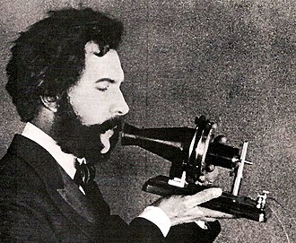 History of sound recording - In the early days of sound recording, acoustic recording devices still used horns instead of microphones. Image displays a mid-1920s re-enactment of Alexander Graham Bell inventing the telephone