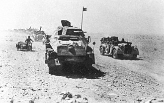 "Kampfgruppe - The Panzerjäger-Abteilung 39 (part of ""Kampfgruppe Gräf"", from the 21st Panzer Division) of the Afrika Korps on the move. The vehicles are a Sd.Kfz. 231 8-rad and motorcycle sidecar combination"