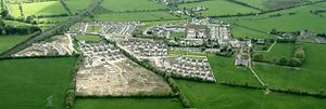 Caragh - Aerial shot of Caragh village (c. 2004)