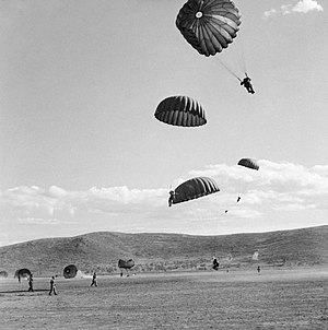 Airborne troops of 'C' Company, 4th Battalion, 2nd Parachute Brigade descending on Megara in Greece, October 1944. NA19340.jpg